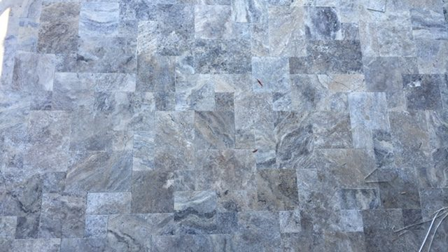 Transforming a worker's cottage into a modern home using Travertine tiles