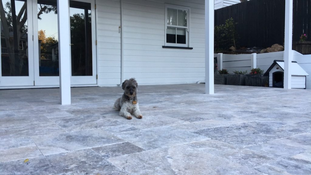 Transforming a worker's cottage into a modern home with Travertine tiles