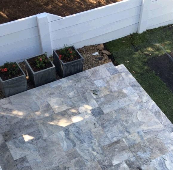 Bardon Cottage renovation using grey Travertine tiles