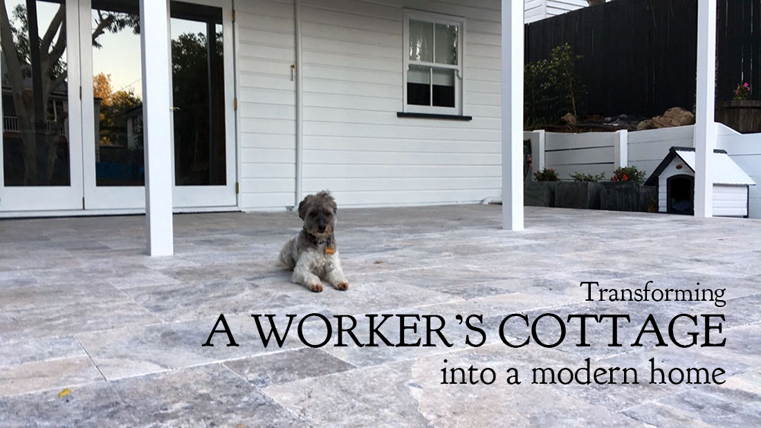 Transforming a worker's cottage into a modern home using Travertine outdoor tiles